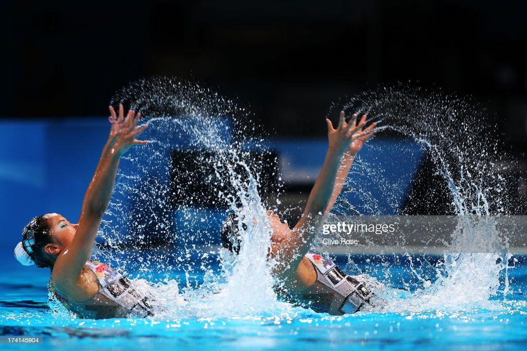 Yumi Adachi and Yukiko Inui of Japan compete in the Synchronized Swimming Duet Technical preliminary round on day two of the 15th FINA World Championships at Palau Sant Jordi on July 21, 2013 in Barcelona, Spain.