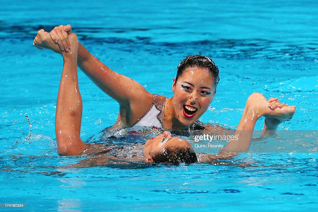 Yumi Adachi and Yukiko Inui of Japan compete in the Synchronized Swimming Duet Technical final on day two of the 15th FINA World Championships at Palau Sant Jordi on July 21, 2013 in Barcelona, Spain.