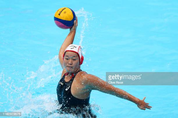 Yumi Arima of Japan takes a shot against Italy during their Women's Water Polo Preliminary round match on day four of the Gwangju 2019 FINA World...