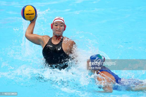 Yumi Arima of Japan takes a shot against Valeria Palmieri of Italy during their Women's Water Polo Preliminary round match on day four of the Gwangju...