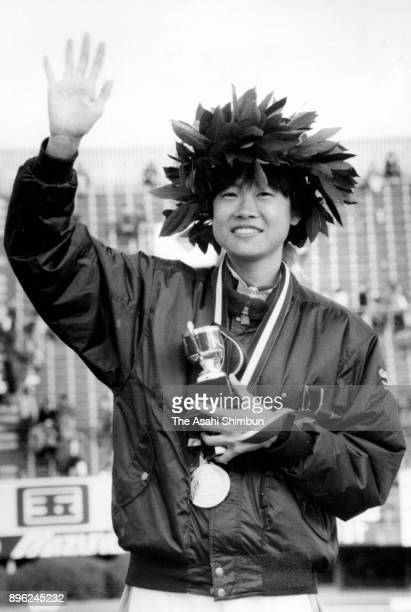 Yumi Kokamo of Japan celebrates on the podium after winning the 11th Osaka International Women's Marathon at Nagai Stadium on January 26 1992 in...