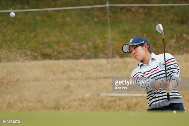 Yumi Kudo of Japan plays a shot from a bunker on the 1st hole during the final round of the Hanasaka Ladies Yanmar Golf Tournament at Biwako Country...