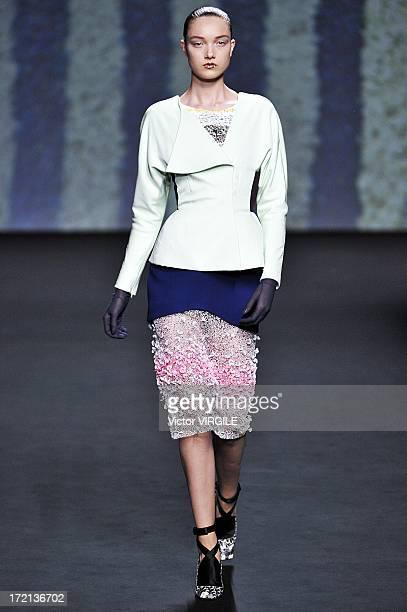 Yumi Lambert walks the runway during the Christian Dior show as part of Paris Fashion Week HauteCouture Fall/Winter 20132014 at Hotel Des Invalides...