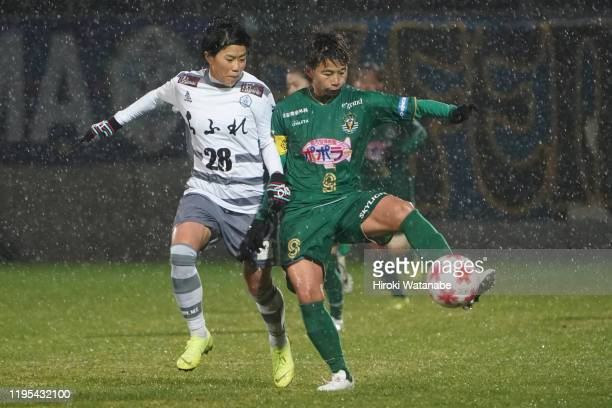 Yumi Uetsuji of AS Elfen Saitama and Mina Tanaka of NTV Beleza compete for the ball during the Empress Cup 41st JFA Women's Championship Semi Final...