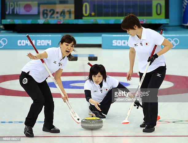 Yumie Funayama of Japan deleivers the stona as Chinami Yoshida and Michiko Tomabechi follow the stone during the Curling Women's Round Robin match...