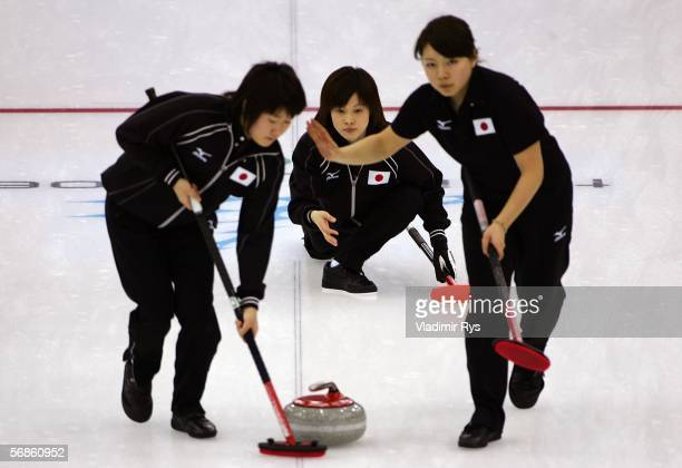 Yumie Hayashi , Moe Meguro and Mari Motohashi of Japan compete during the preliminary round of the women's curling between Japan and Denmark during...