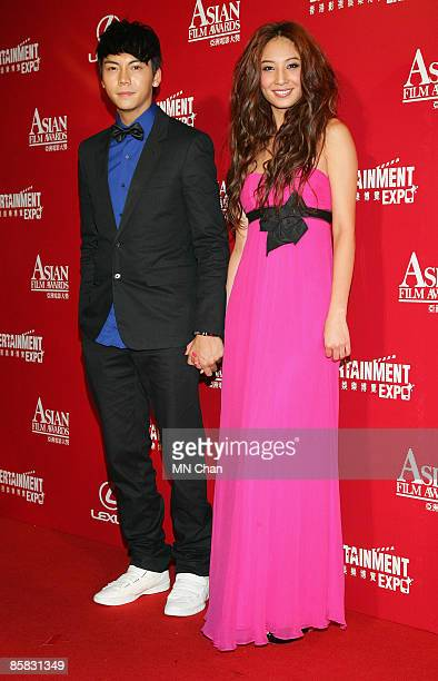Yumiko Cheng and William Chan arrive at the Asian Film Awards 2009 at the Hong Kong Convention and Exhibition Centre on March 23, 2009 in Hong Kong.