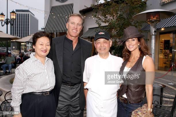 Yumiko Nozawa former NFL quarterback John Elway chef Nozawa and actress paige Green attend the SugarFish by Sushi Nozawa grand opening party on June...