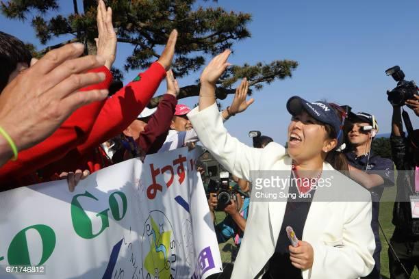 Yumiko Yoshida of Japan celebrates with fans after winning the Fujisankei Ladies Classic at the Kawana Hotel Golf Course Fuji Course on April 23 2017...