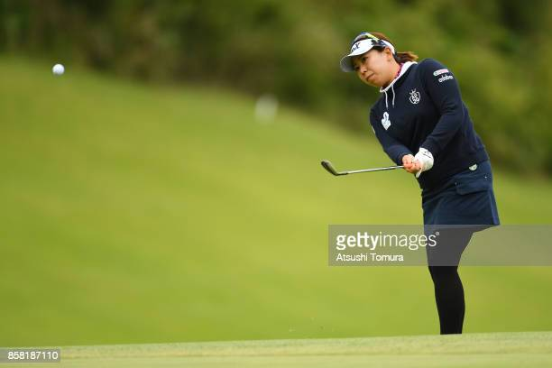 Yumiko Yoshida of Japan chips onto the 18th green during the first round of Stanley Ladies Golf Tournament at the Tomei Country Club on October 6,...