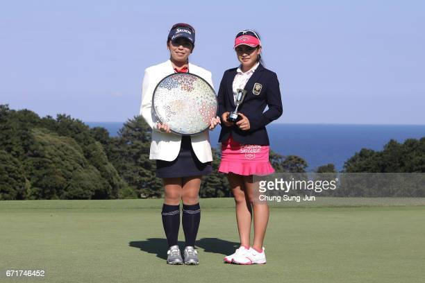 Yumiko Yoshida of Japan lifts the Championship's trophy with best amature winner Yui Kawamoto during a ceremony following the Fujisankei Ladies...