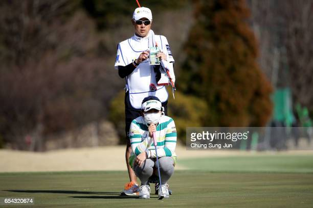 Yumiko Yoshida of Japan looks over a green on the 18th hole in the first round during the T-Point Ladies Golf Tournament at the Wakagi Golf Club on...