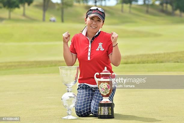 Yumiko Yoshida of Japan poses with the trophy after winning the Chukyo Television Bridgestone Ladies Open at the Chukyo Golf Club Ishino Course on...
