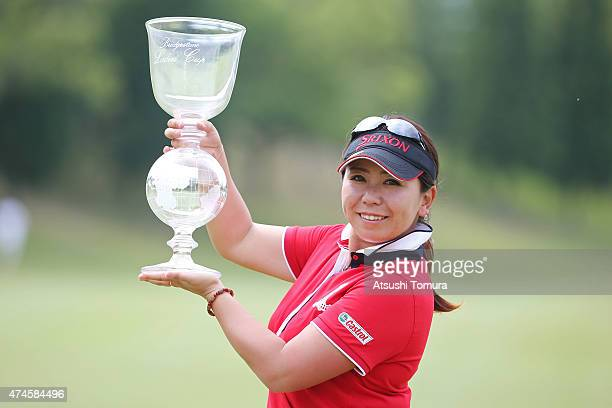 Yumiko Yoshida of Japan poses with the trophy after winning the Chukyo Television Bridgestone Ladies Open at the Chukyo Golf Club Ishino Course on...