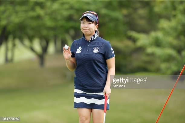 Yumiko Yoshida of Japan waves to the gallery on the first green during the first round of the CyberAgent Ladies Golf Tournament at Grand fields...