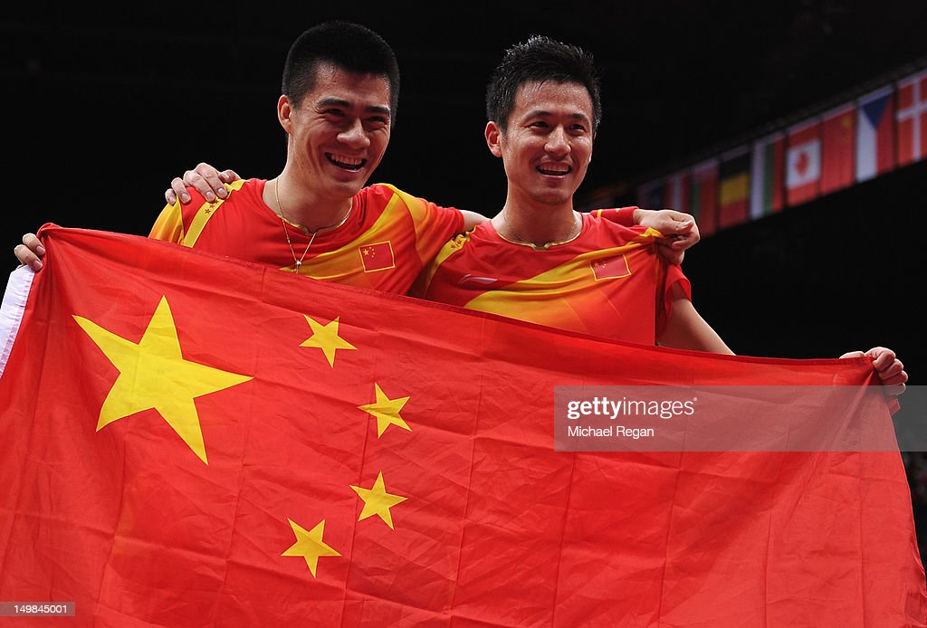 Yun Cai and Haifeng Fu (L) of China celebrate victory against Mathias Boe and Carsten Mogensen of Denmark in their Men's Doubles Badminton Gold Medal match on Day 9 of the London 2012 Olympic Games at Wembley Arena on August 5, 2012 in London, England.