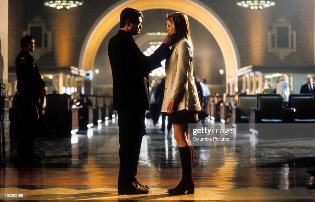 Yun Fat Chow says goodbye to Mira Sorvino in a scene form the film