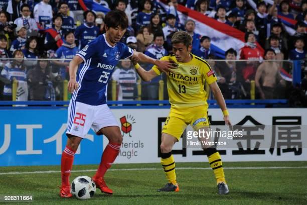 Yun Ii Lok of Yokohama FMarinos and Ryuta Koike of Kashiwa Reysol compete for the ball during the JLeague J1 match between Kashiwa Reysol and...