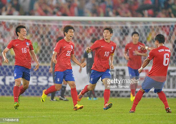 Yun Illok of South Korea celebrates scoring his team's first goal with his team mates Lee Myungjoo Ha Daesung and Hong Jeongho during the EAFF East...