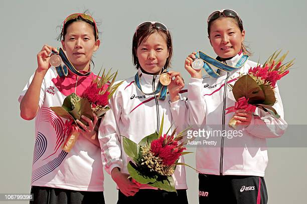 Yun Jung Jang of South Korea Mariko Adachi of Japan and Akane Tsuchihashi of Japan pose with the medals won in the Women's Individual Triathlon at...