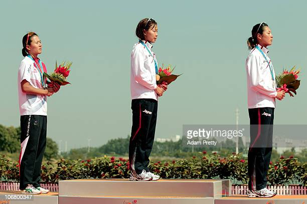 Yun Jung Jang of South Korea Mariko Adachi of Japan and Akane Tsuchihashi of Japan listen to the anthems with the medals won in the Women's...