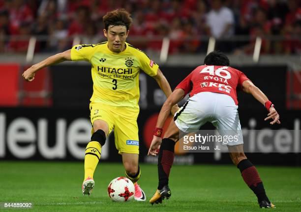 Yun Suk Young of Kashiwa Reysol takes on Ryota Moriwaki of Urawa Red Diamonds during the JLeague J1 match between Urawa Red Diamonds and Kashiwa...