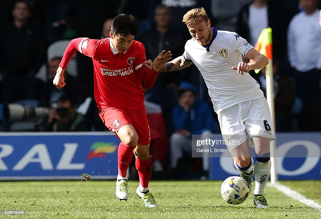 Yun Suk-Young of Charlton Athletic FC and Liam Cooper of Leeds United FC compete for the ball during the Sky Bet Championship match between Leeds United and Charlton Athletic at Elland Road on April 30, 2016 in Leeds, United Kingdom.
