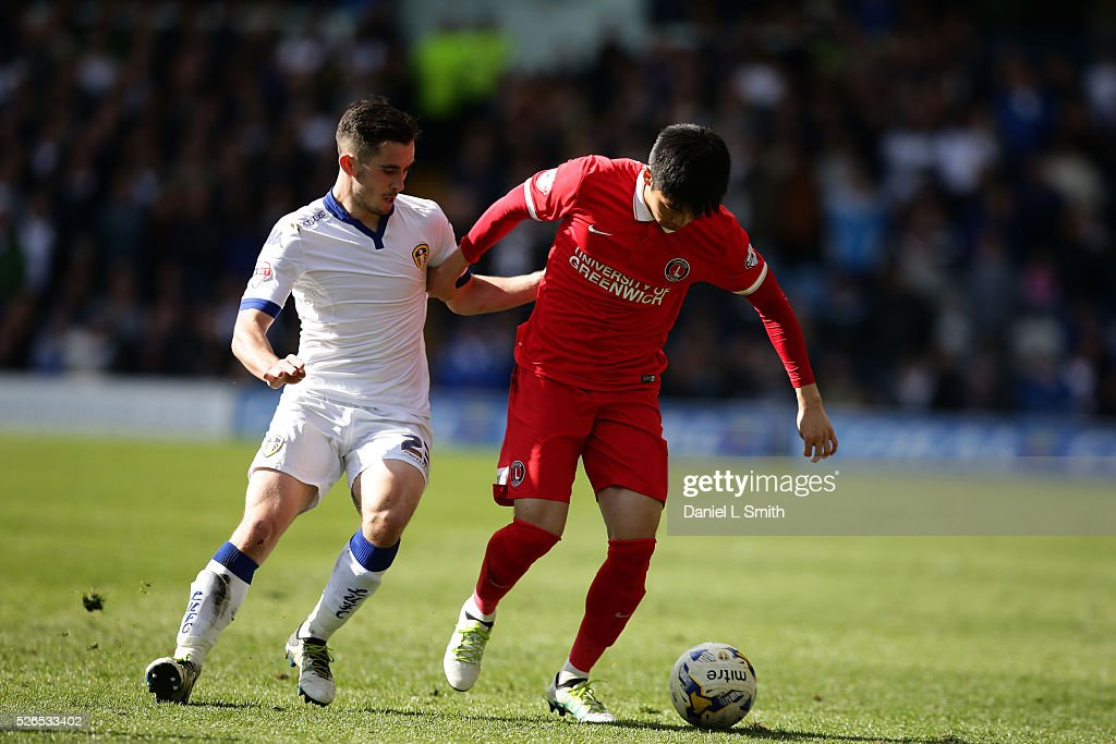 Yun Suk-Young of Charlton Athletic FC holds off Lewis Cook of Leeds United FC during the Sky Bet Championship match between Leeds United and Charlton Athletic at Elland Road on April 30, 2016 in Leeds, United Kingdom.