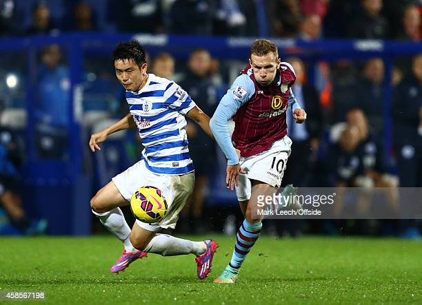 Yun SukYoung of QPR tangles with Andreas Weimann of Aston Villa during the Premier League match between Queens Park Rangers and Aston Villa at Loftus...