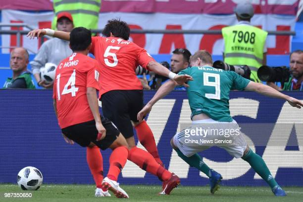 Yun Youngsun of Korea Republic and Timo Werner of Germany compete for the ball in the 2018 FIFA World Cup Russia group F match between Korea Republic...