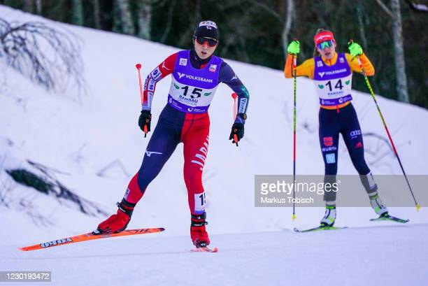 Yuna Kasai of Japan and Jenny Nowak of Germany competes during the Women's Gundersen Normal Hill HS98/5.0 Km at the FIS Nordic Combined World Cup at...