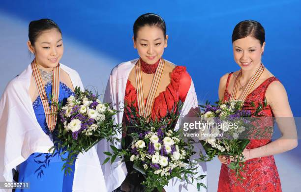 Yu-Na Kim of Korea, Mao Asada of Japan and Laura Lepisto of Finland pose with their medals after the Ladies Free Skate during the 2010 ISU World...