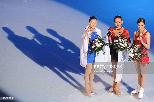 YuNa Kim of Korea Mao Asada of Japan and Laura Lepisto of Finland pose with their medals after the Ladies Free Skate during the 2010 ISU World Figure...