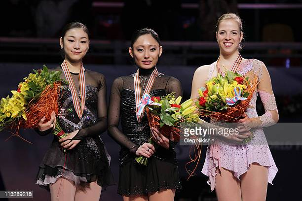 Yuna Kim of Korea Miki Ando of Japan and Carolina Kostner of Italy smile on the podium after winning the ladies's event of the ISU World Figure...