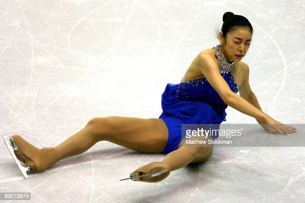 YuNa Kim of South Korea falls to the ice in the Free Skate during the CancerNet Skate America at Herb Brooks Arena on November 15 2009 in Lake Placid...