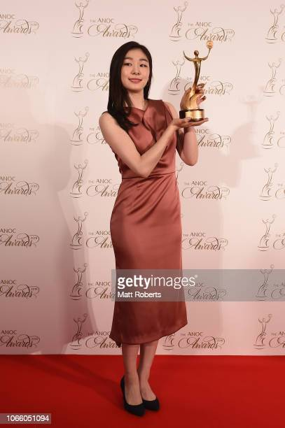 Yuna Kim of South Korea with the Outstanding Performance award during the gala awards evening following day one of the XXIII ANOC General Assembly...