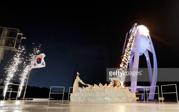 Yuna Kim South Korean Figure Skater lights the cauldron during the Opening Ceremony of the PyeongChang 2018 Winter Olympic Games at PyeongChang...