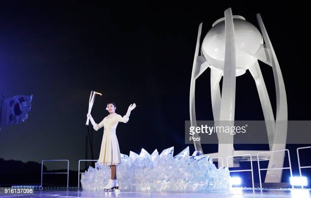 Yuna Kim South Korean Figure Skater prepares to light the caulderon during the Opening Ceremony of the PyeongChang 2018 Winter Olympic Games at...