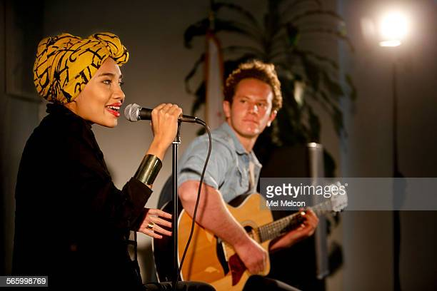 Yuna left an up and coming singer songwriter from Malaysia performs for a group of Universal Music Executives in the Bob Marley room at Universal...
