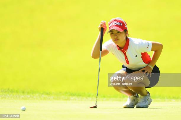 Yuna Nishimura of Japan lines up her putt on the 2nd hole during the third round of the Toyota Junior Golf World Cup at Chukyo Golf Club on June 14...
