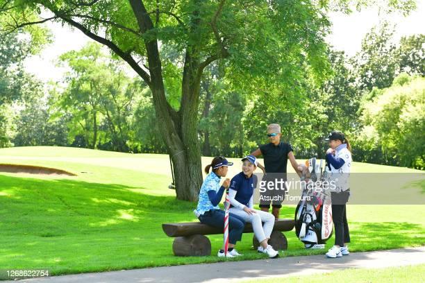 Yuna Takagi Akira Yamaji and Mizuki Tanaka of Japan talk during a practice round ahead of the Nitori Ladies Golf Tournament at the Otaru Country Club...