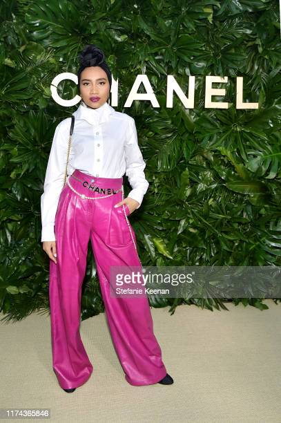Yunawearing CHANEL attends Chanel Dinner Celebrating Gabrielle Chanel Essence With Margot Robbie on September 12 2019 in Los Angeles California
