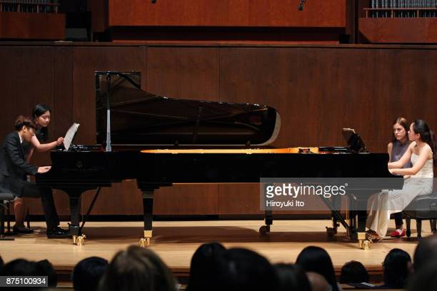 YunChin Zhou left and Chaeyoung Park the winners of the 2017 Gina Bachauer Piano Competition performing William Bolcom's Recuerdos for Two Pianos at...