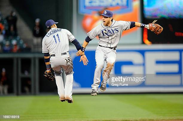 Yunel Escobar and Ben Zobrist of the Tampa Bay Rays celebrate after a 106 victory against the Baltimore Orioles at Oriole Park at Camden Yards on May...