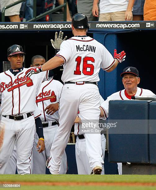 Yunel Escobar Brian McCann and manager Bobby Cox of the Atlanta Braves against the Kansas City Royals at Turner Field on June 19 2010 in Atlanta...