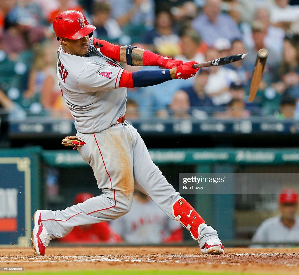Yunel Escobar #0 of the Los Angeles Angels of Anaheim breaks his bat as hr doubles in the third inning against the Houston Astros at Minute Maid Park on June 9, 2017 in Houston, Texas.