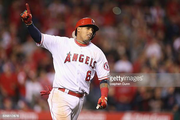 Yunel Escobar of the Los Angeles Angels of Anaheim celebrates as he runs to first after hitting a walk off RBI single in the ninth inning against the...
