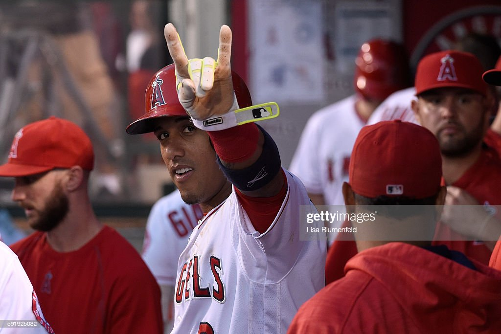 Yunel Escobar #6 of the Los Angeles Angels of Anaheim celebrates in the dugout after scoring in the first inning against the Seattle Mariners at Angel Stadium of Anaheim on August 18, 2016 in Anaheim, California.