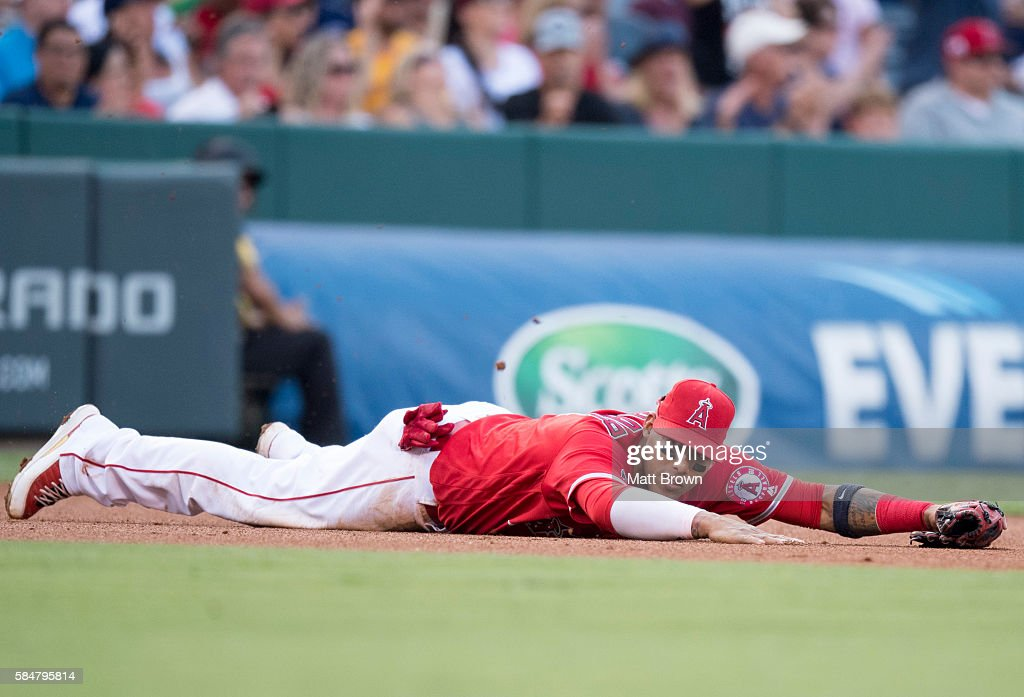 Yunel Escobar #6 of the Los Angeles Angels of Anaheim reacts after making a diving miss on a RBI single ball hit by Hanley Ramirez of the Boston Red Sox during the first inning of the game at Angel Stadium of Anaheim on July 30, 2016 in Anaheim, California.