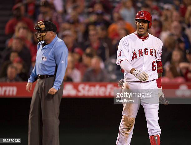 Yunel Escobar of the Los Angeles Angels of Anaheim reacts to striking out during the game against the Baltimore Orioles at Angel Stadium of Anaheim...